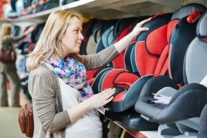 pregnant woman selecting safe car seat